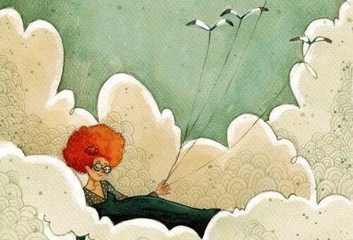 Rödhårig kvinna med fåglar