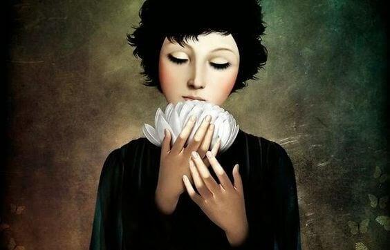 Kvinna med vit blomma