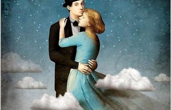 Man och kvinna håller om varandra mot bakgrund av stjärnor