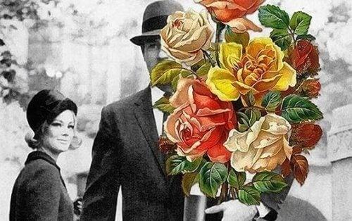Man med blommor till kvinna