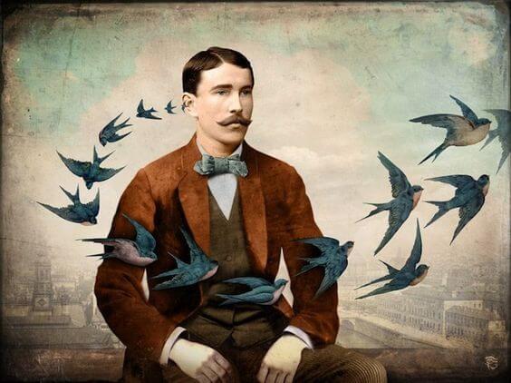 Man som är omgiven av fåglar.