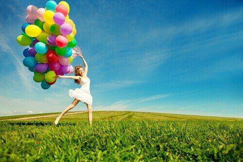 Person med ballonger