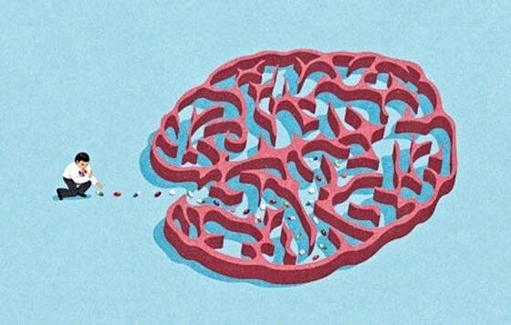 Man som leker med en hjärna.