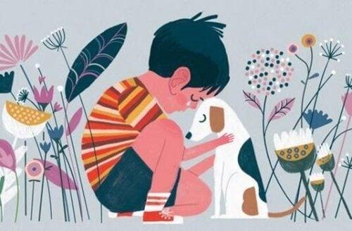 Pojke som sitter med hund.