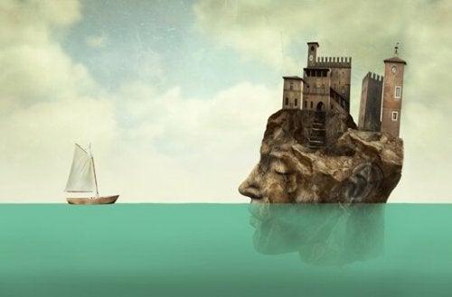 Skepp och ö formad som ett huvud.