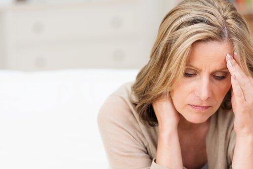 En sorglig kvinna med typ c personlighet