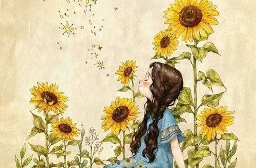 Leende flicka bland solrosor