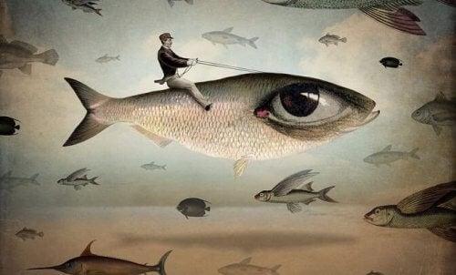 Man som rider på fisk.