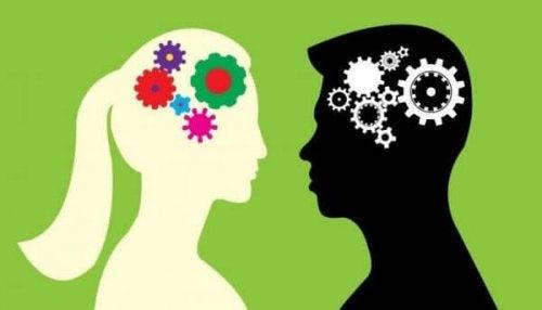 Man och kvinna med kugghjul i hjärnan
