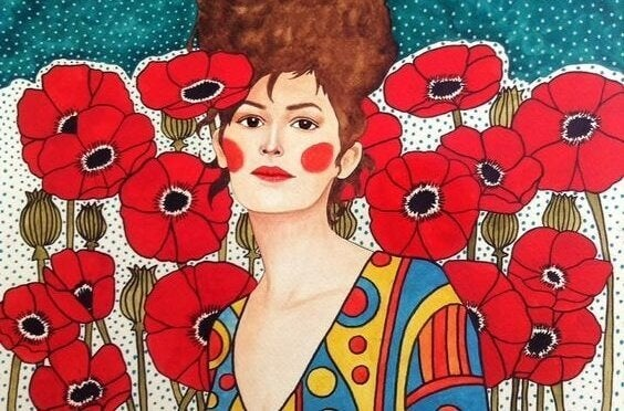Kvinna bland röda blommor.