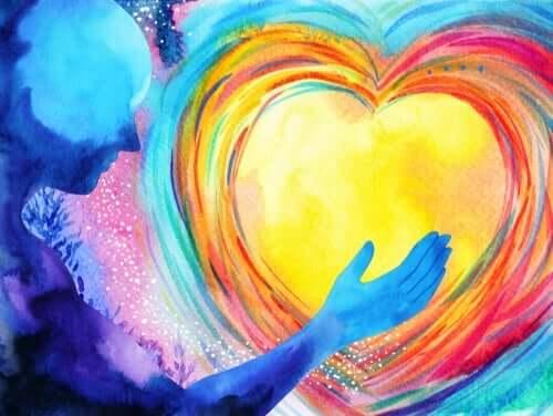 Person med färgat hjärta