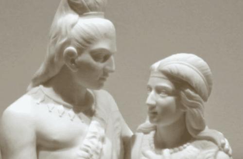 Skulptur av man och kvinna.
