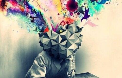 En persons mångfärgade tankar bryter sig loss från kubism-huvud genom kreativt avlärande