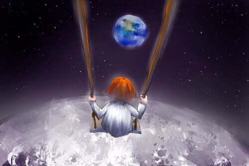 Pojke i en gunga på månen med önskan om ett kalejdoskop