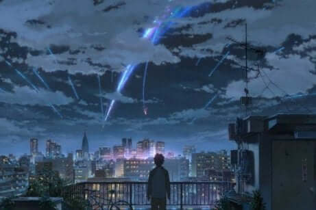 En ung person som tittar ut över en stad där meteorer faller från himlen